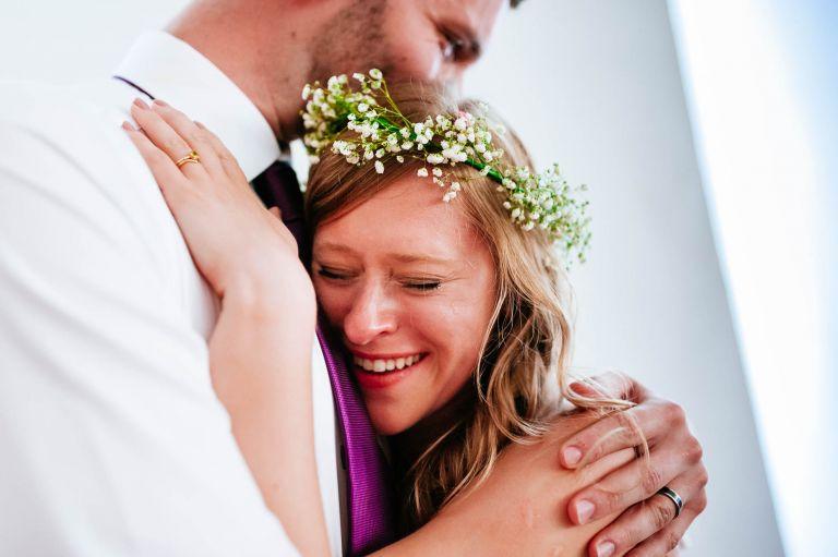 bride and groom big hug