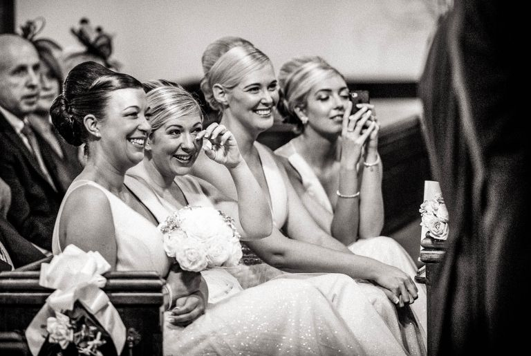 bridesmaids shed a tear during wedding vows