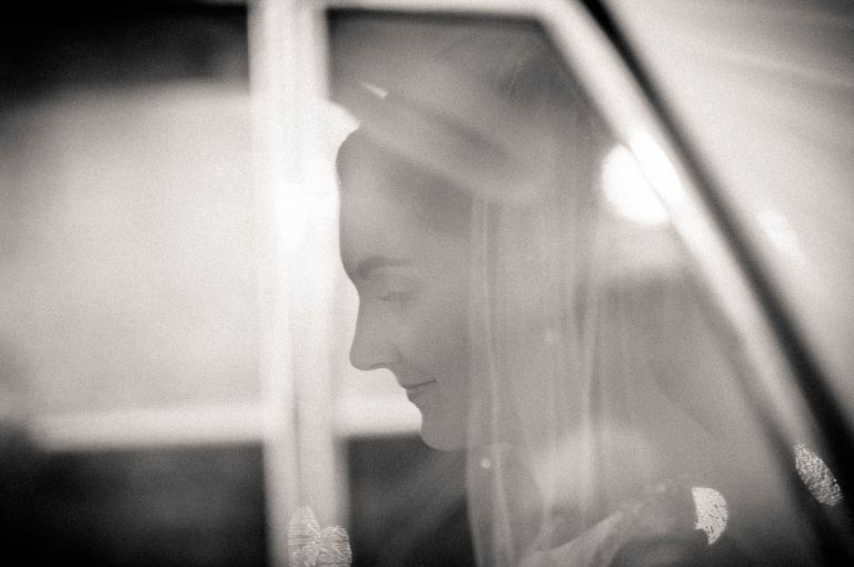 bride in car arriving at church