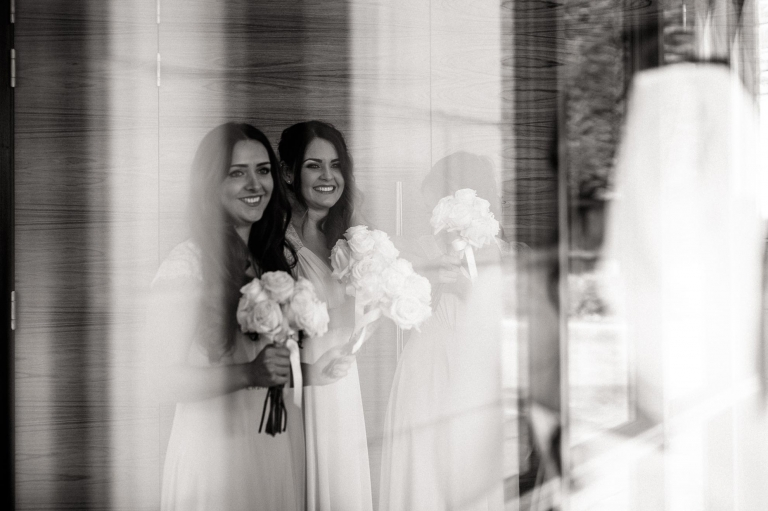 bridesmaids smile as the bride arrives at the wedding venue