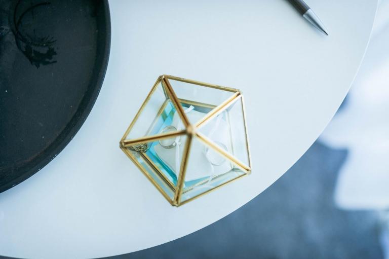 wedding rings in ornamental glass case