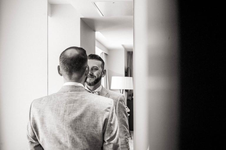 Luke smiles in the mirror