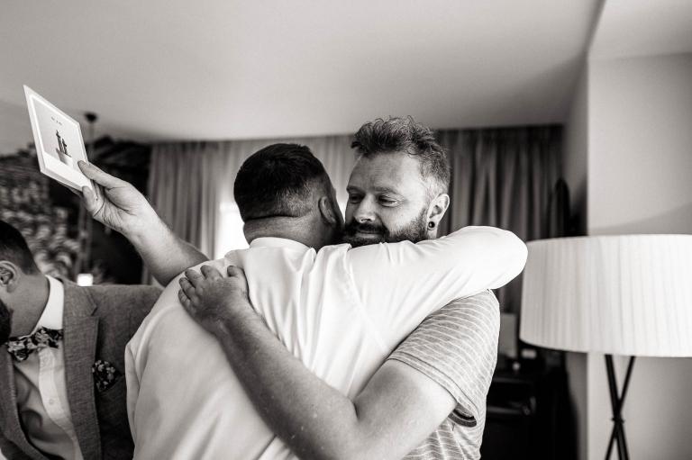 Mike hugs his friend