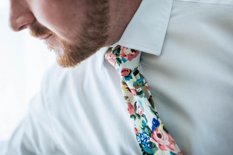 Mike adjusts his floral tie