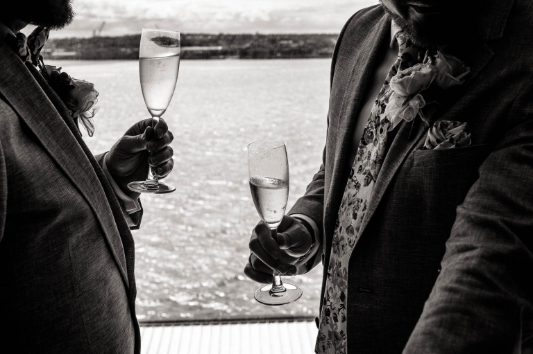 Luke and Mike enjoy a glass of champagne