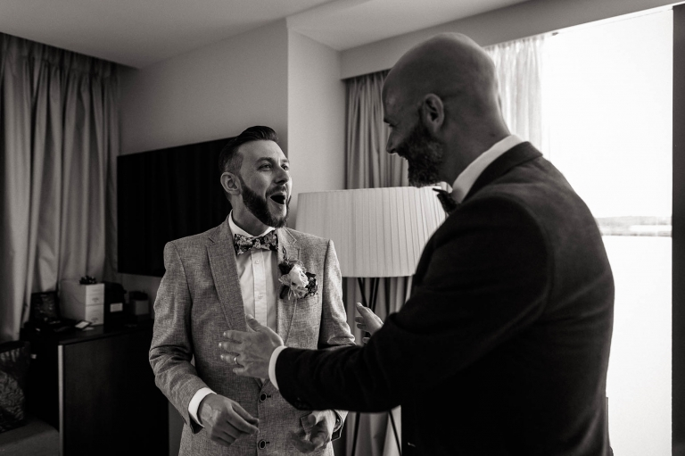luke and a wedding guest share a joke