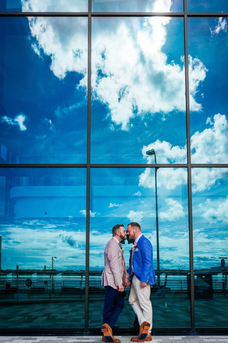 luke and mike share a moment with reflections of clouds in window