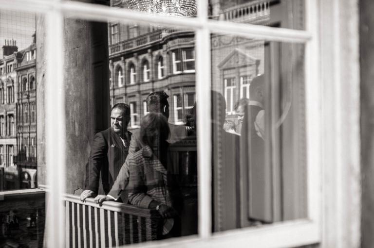 mans reflection in mirror