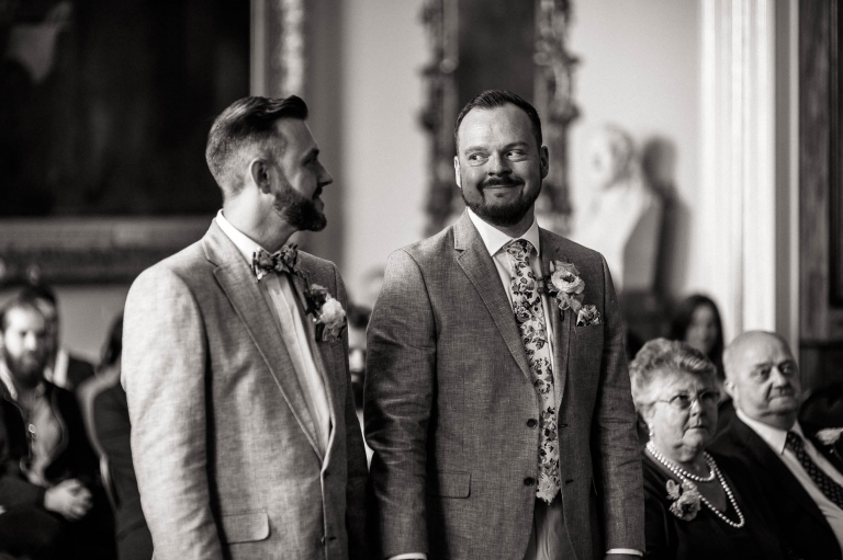 mike smiles at luke as they are married