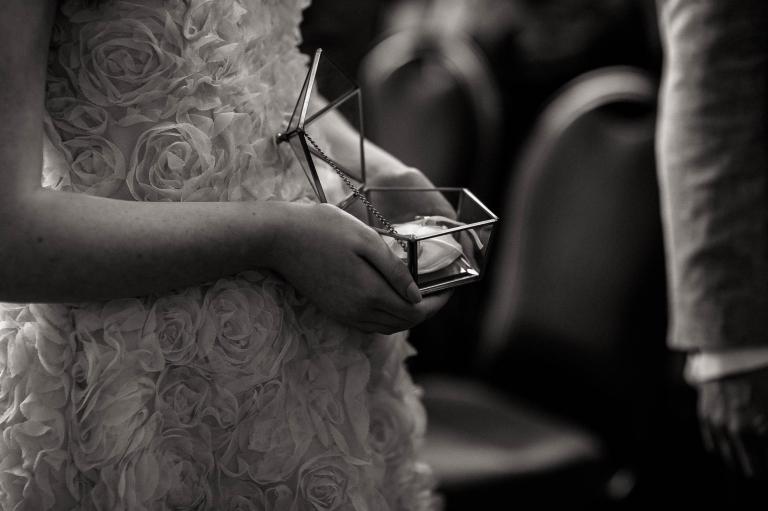 flower girl holds the wedding rings