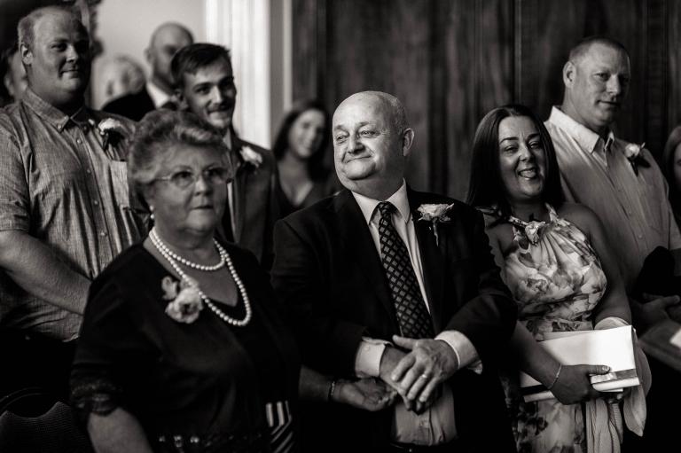luke's mum and dad look on