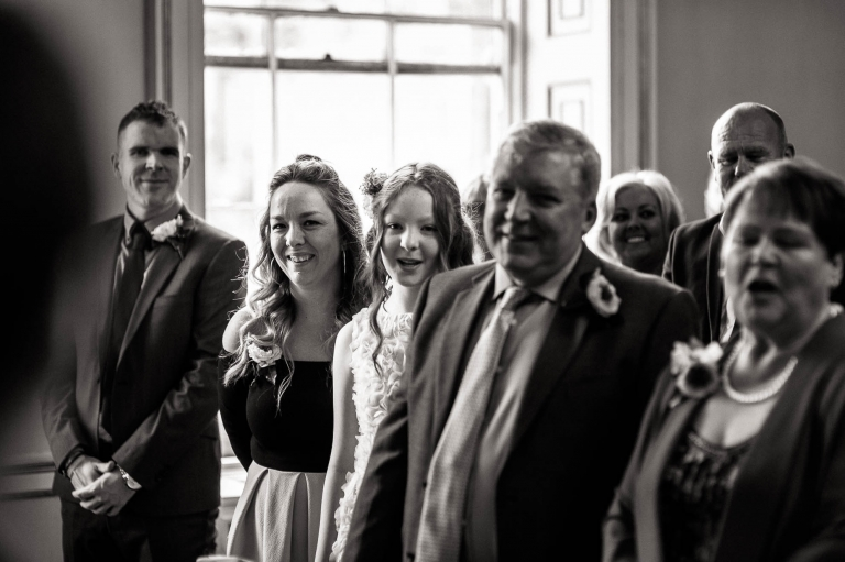 mikes family smile as they say their wedding vows