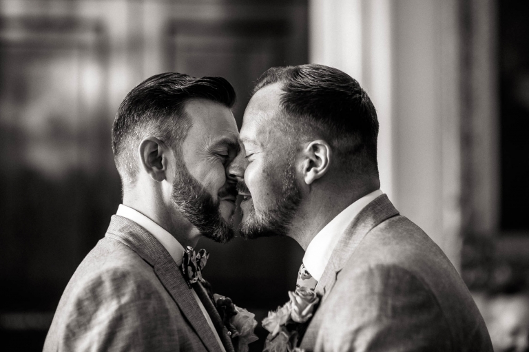 luke and mike kiss after the exchange of wedding rings