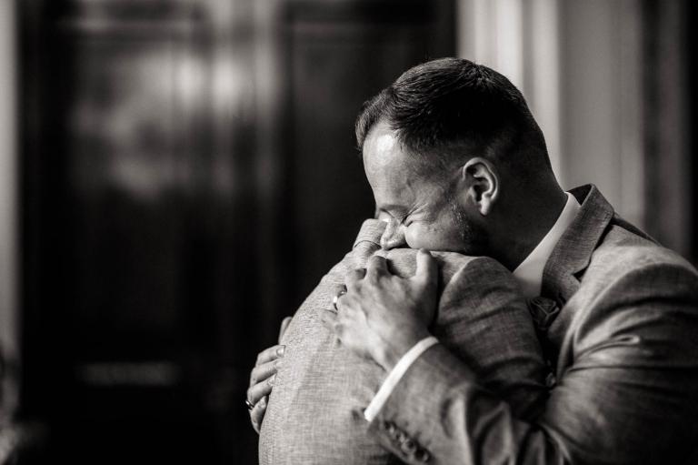 luke & mike hug after the ring exchange