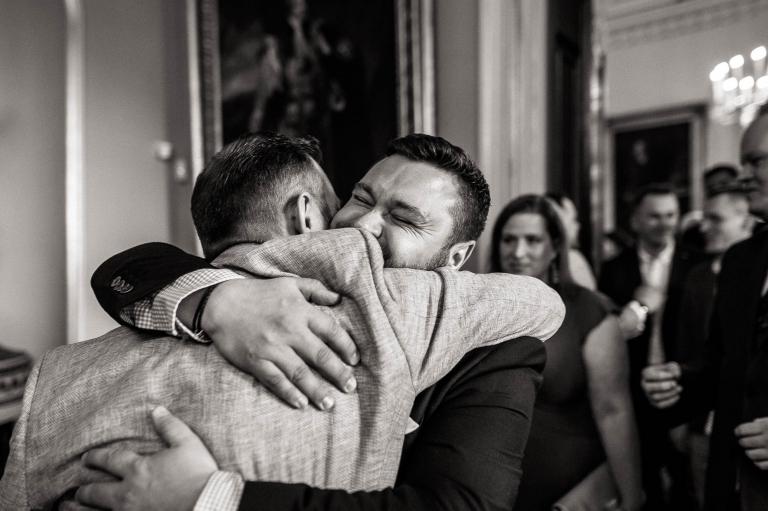 a guest hugs Luke