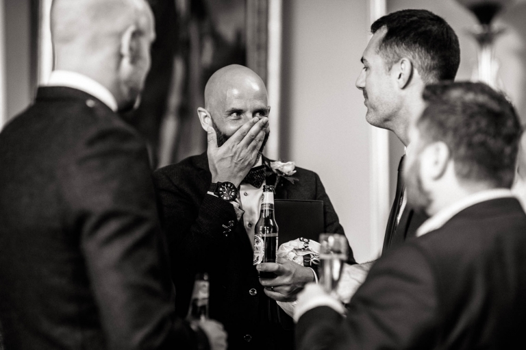 a guest laughs at a joke