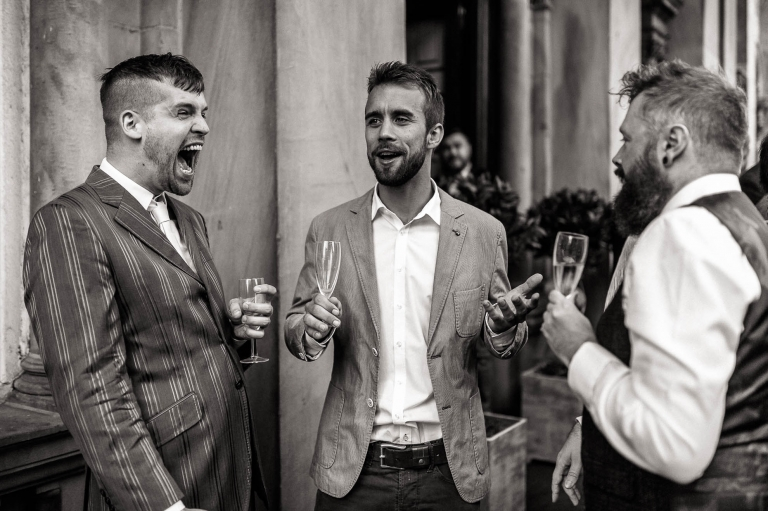 a guest laughs loudly at a joke