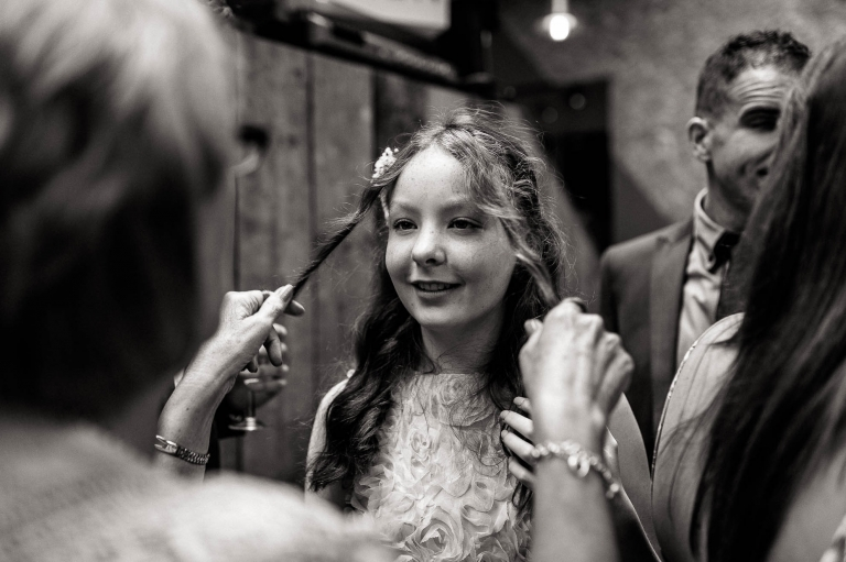 a guest plays with a young girls hair