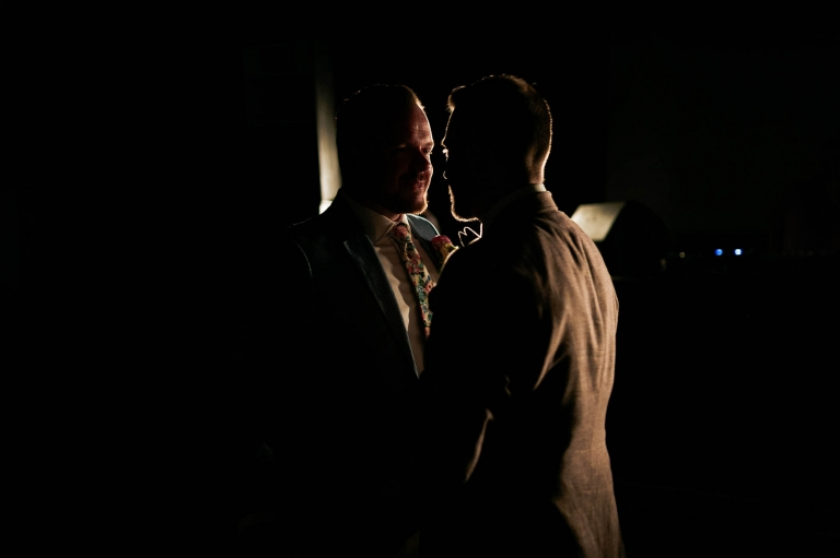 Luke & mike silhouetted during the first dance
