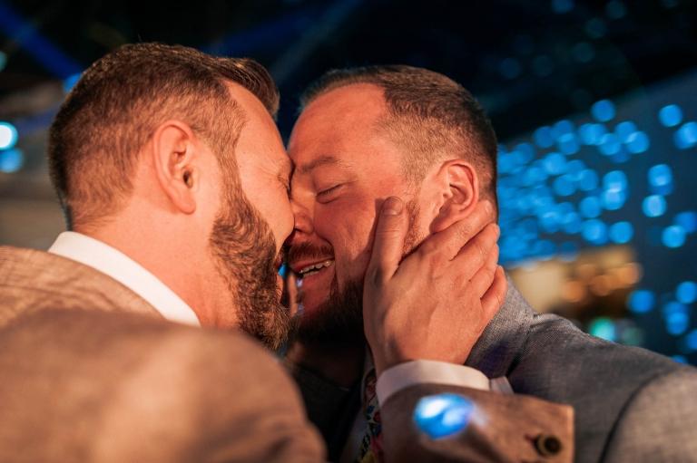 Luke & Mike hug during the first dance