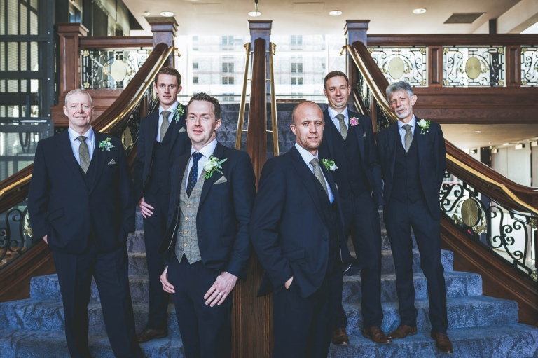 groom and his groomsmen formal photograph on titanic staircase