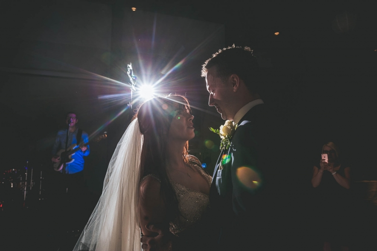 bride and groom look int each other's eyes during the first dance