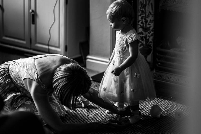 Grandmother dresses little girl