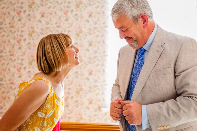 Brides mother and father share a joke