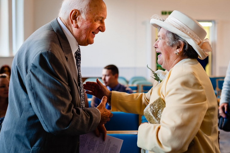 Grooms grandparents greet each other