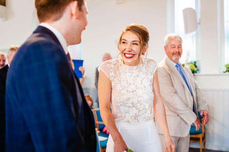 Bride gives groom a big smile