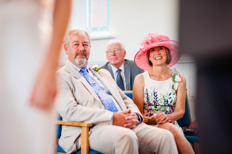 Mother of the bride smiles as she looks on