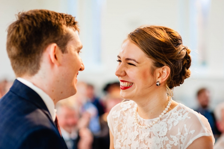 Bride and groom smile as they are announced married