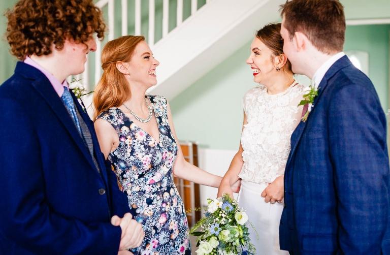 Bride and witness share a joke