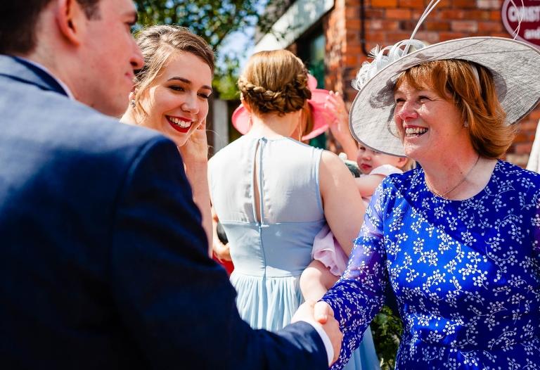 Grooms mother congratulates groom