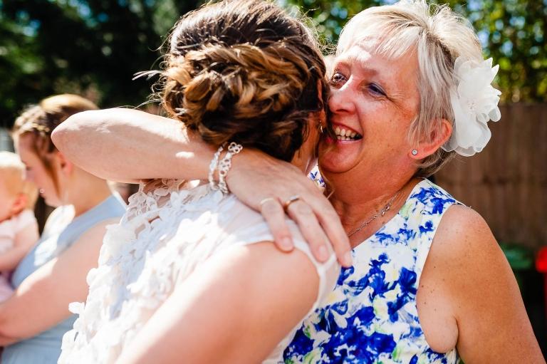 Guest gives bride a big hug