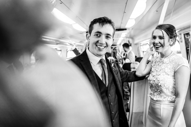 Bride and groom ride on train