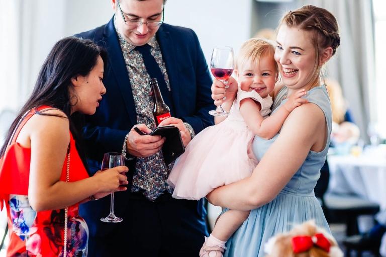 Bridesmaid and daughter share a joke