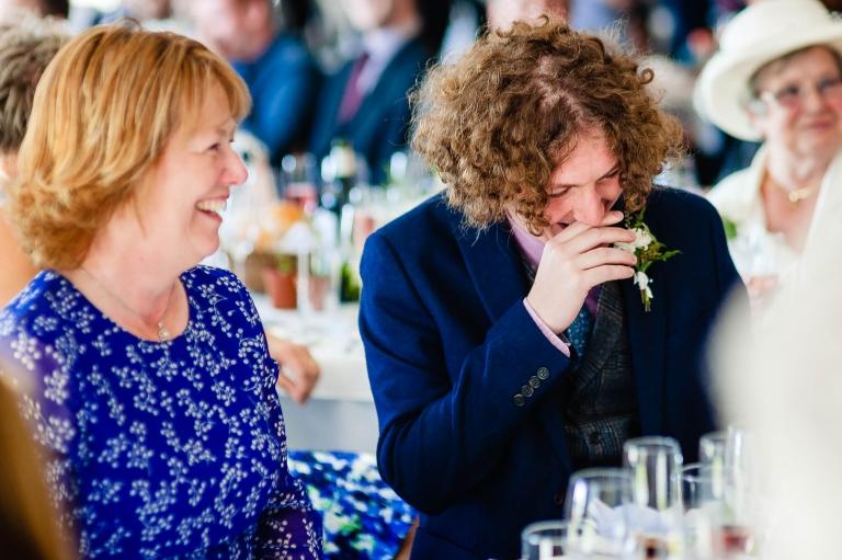 Best man laughs at grooms speech