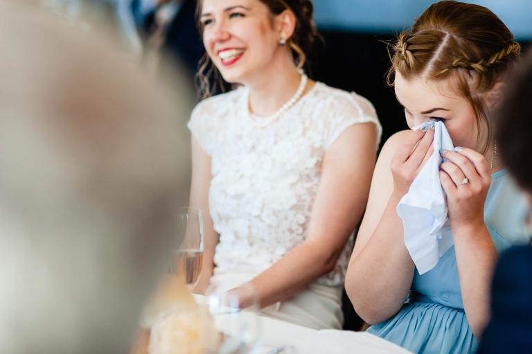 Bridesmaids wipes away a tear