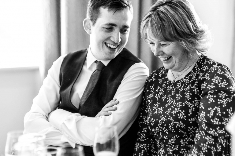 groom sharing a joke with his mother