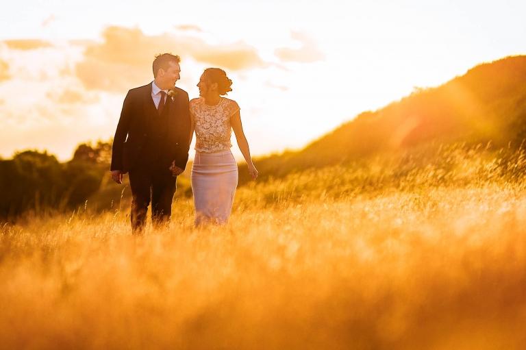 Newlyweds walking in sunset