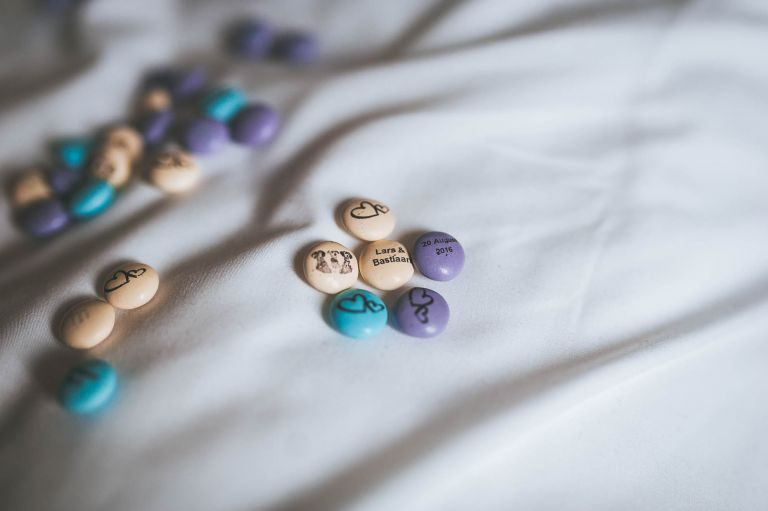 M&M sweets on bed