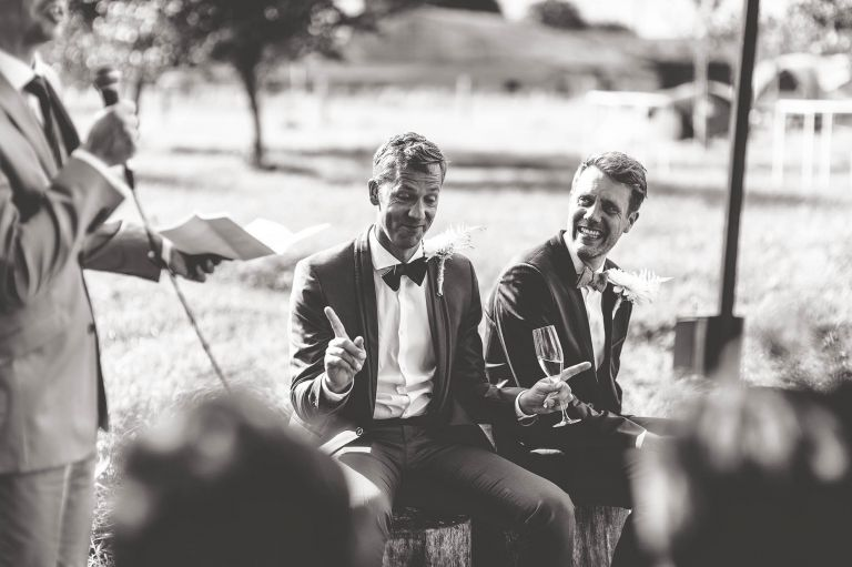 Groom laughing at guests speech