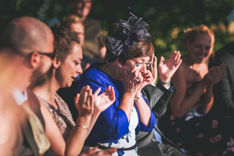 Mother of the groom wipes away tears