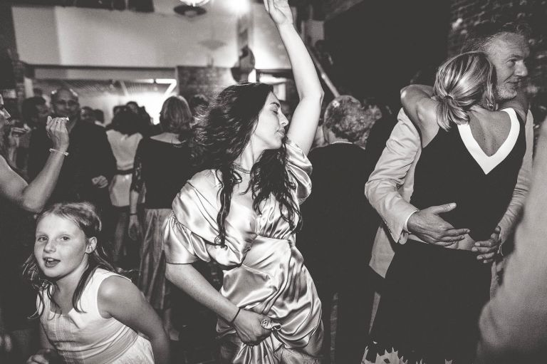 Guest dancing with hands in the air