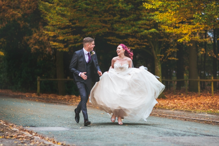 Bride and groom run together