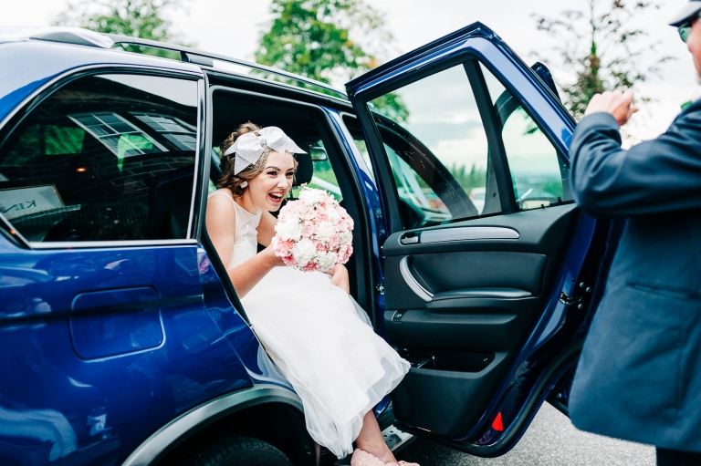 Bride steps out of the wedding car