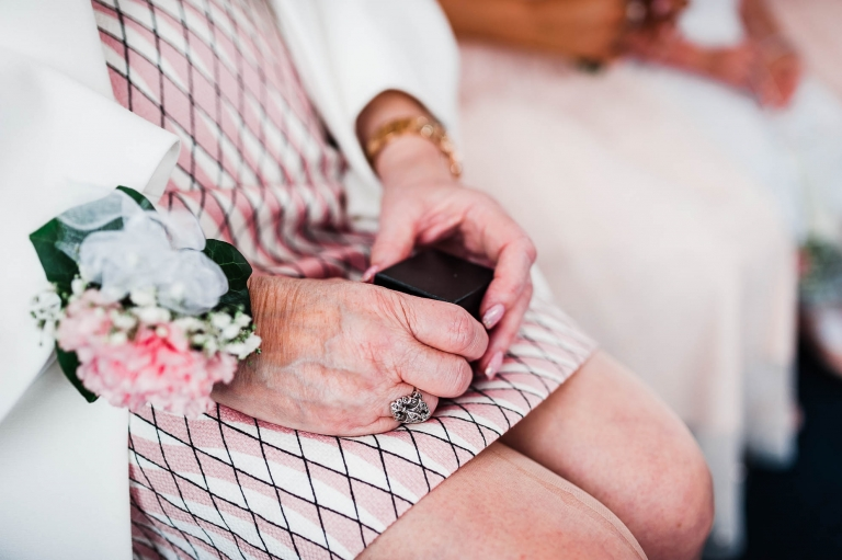Mother of the groom holding the wedding rings