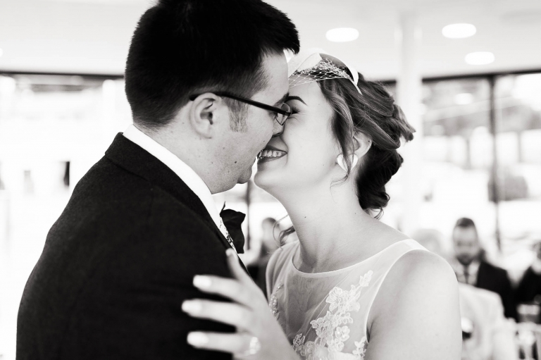 Newly weds kiss after being declared married