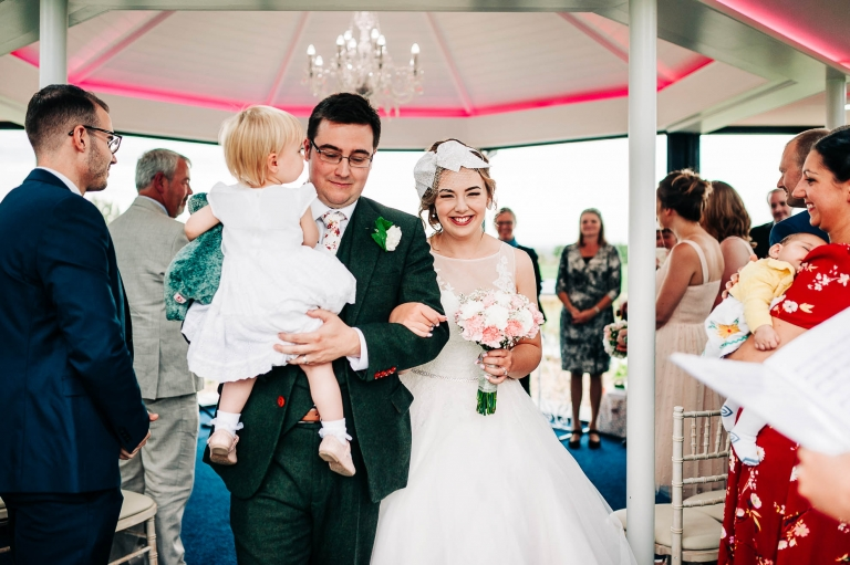 The newly weds walk back down the aisle